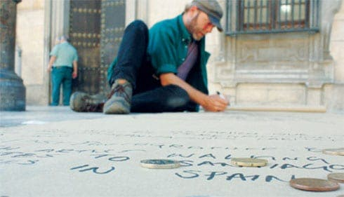 SKETCHING: John Colley works on his pavement art in northern Spain