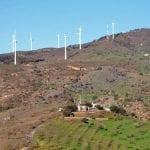 turbines stand like huge children