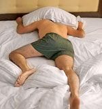 man sleeps in wrong bed