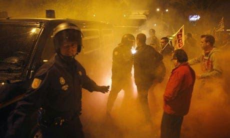 Demonstrators clash with police in Malaga as general strike begins