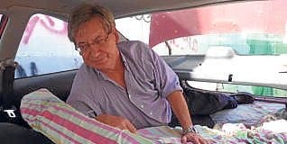 dentist sleeping in his car cannot afford to pay rent