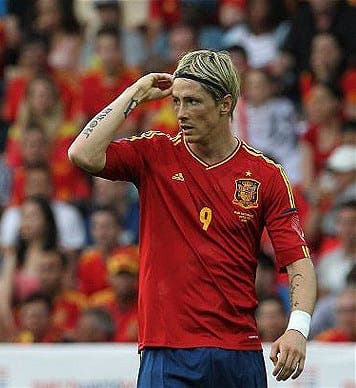 Torrid for Torres in Spain's opening match