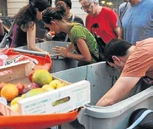 Spanish 'freeganism' movement converts trash into dinner