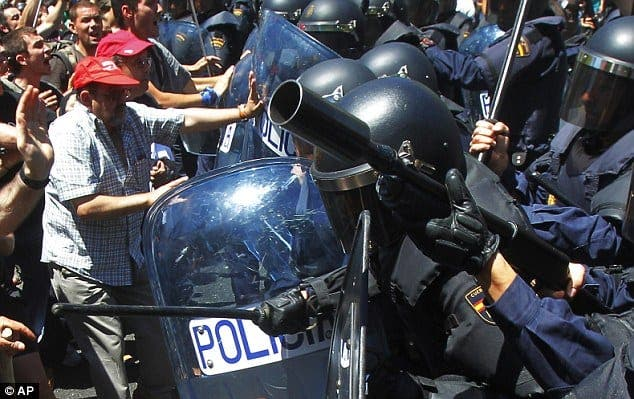 Spain pays the price of financial folly: As airports and luxury flats stand empty as monuments to Spain's overspending, miners' protest over subsidy cuts ends in bloody clashes