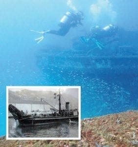 Divers explore the wreck of the 482, while (inset below) the boat in its heyday