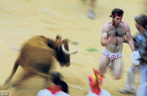 The lunacy begins as thousands flock to Pamplona to run with the bulls
