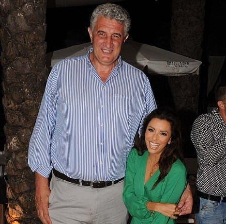 Little and large: Petite star Eva Longoria poses with fellow diner in Marbella