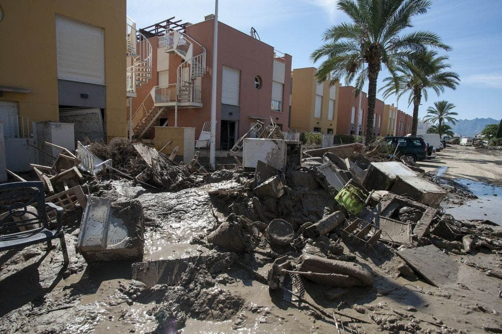 Spanish homeowners dealing with fires and floods will have to pay