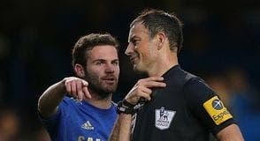 Referee Mark Clattenburg with Chelsea player Juan Mata
