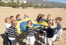 School children playing on beach