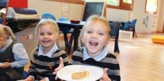 Sophie and India enjoying their pancakes