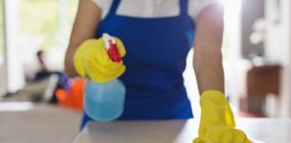 Woman cleaning kitchen co