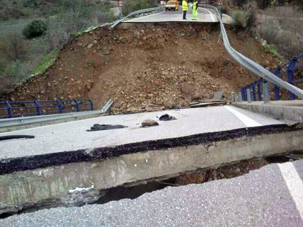 Driver has miraculous escape as road bridge collapses while Andalucia is lashed by storms