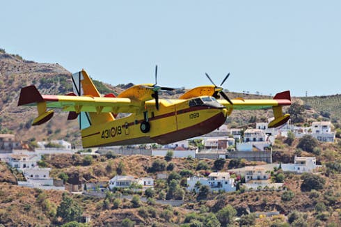 Fire fighting aircraft take on water at Lake Vinuela. Photo by Olive Press reader Derek Squires