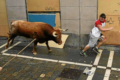 Australian tourist's thigh ripped open by bull in Pamplona