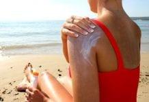 Woman applying sun cream  e