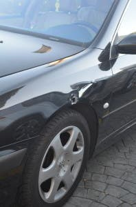 Bullet hole in the car of neighbouring restauranteur. Copyright the Olive Press