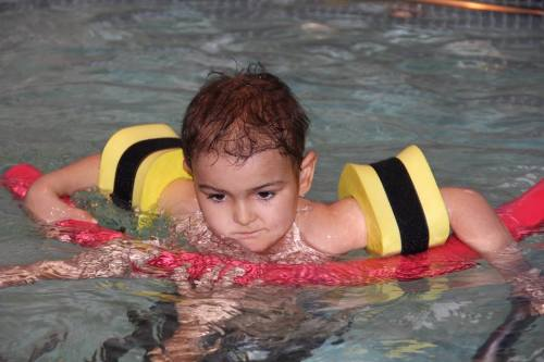 Ashya King looks happy swimming