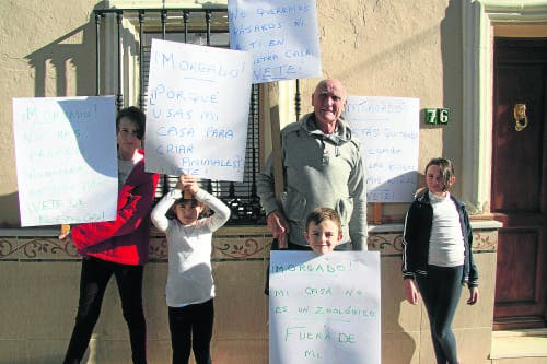 Expat landlord holds protest against tenant who hasn't paid rent for years