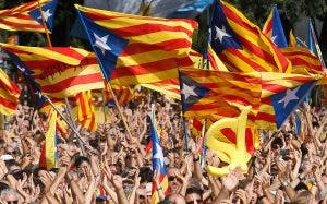 "People wave their ""Esteladas"" (Catalonian separatist flag) flags during a Catalan pro-independence demonstration at Catalunya square in Barcelona"
