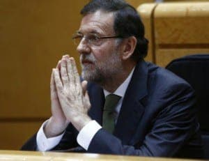 Rajoy praying
