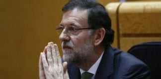 Rajoy praying e