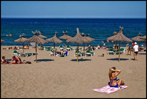 Plummeting oil prices drive 2015 tourist boost for Spain