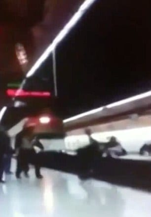 VIDEO: Shocking moment police officer dragged under train at Madrid station