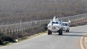 U.N. peacekeepers of UNIFIL patrol the Lebanese-Israeli border, beside Kfar Kila village in south Lebanon