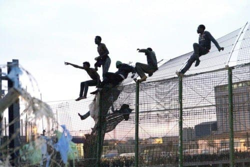 More than 1,000 migrants attempt to cross border into Melilla