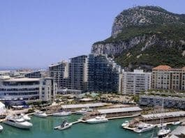 Ocean Village berths with rock behind e