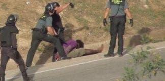 spanish police beat migrant unconscious melilla border fence e