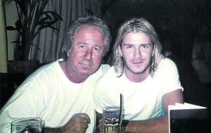 GOLDEN BOYS: Boland, here with David Beckham, was paid €20,000 a month to run REM for Gaspar and Man