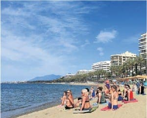 LIFE'S A BEACH: Yoga session on Marbella beach