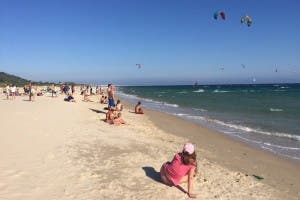 Watching kitesurfers on a Tarifa beach