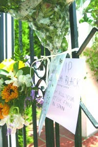 Card pinned to gates outside Cilla's Estepona villa