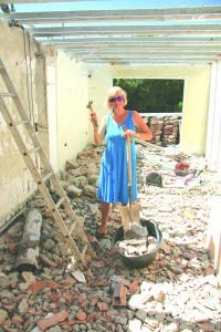 Terttu Balson among the rubble which was her home