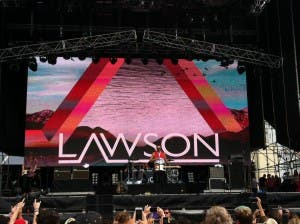 Lawson's lead singer Andy Brown with Gibraltar flag around shoulders