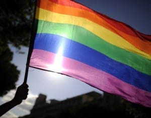 A participants holds a rainbow flag