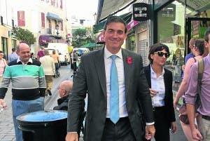 Daniel Feetham strolls down Main Street