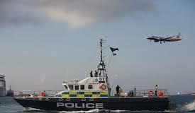 Jet Ski man Gib police boat