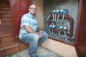 Community president Trevor Walkingshaw inspects pipes Photo: Olive Press Spain