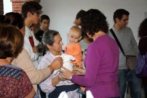 JEREZ: A Spanish mother cradles a young Syrian