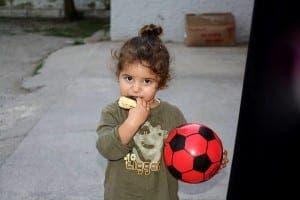 JEREZ: A Syrian child enjoys her toy donation