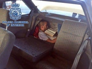 The Moroccan squeezed into a hidden compartment between the back seats of a car and the boot