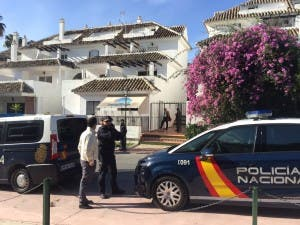 Police enter property for eviction in Marbella. Photo copyright The Olive Press