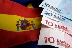 Spanish and EU flag and euro banknotes