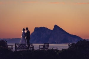 ROCK-SOLID LOVE: Newly weds enjoy a quiet moment in stunning spot overlooking Gibraltar. Photo: Jon Segui