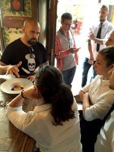 CASANIS: Tulio explains a dish to waiters