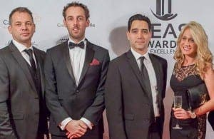 DREAM TEAM: Kelly (left) with colleagues